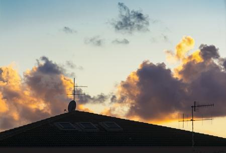 日没時の屋根と空中 写真素材