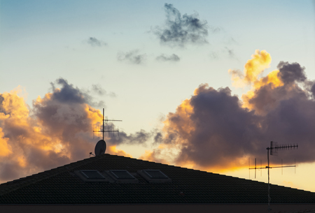 Roof and aerials at sunset