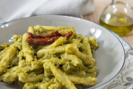 typical italian pasta with broccoli and dried tomatoes sauce