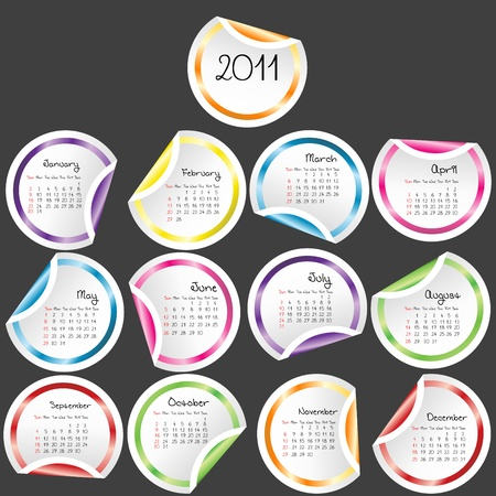 julie: 2011 Calendar with colored stickers on grey background Stock Photo