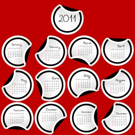 julie: 2011 Calendar with stickers with black borders on red background Stock Photo