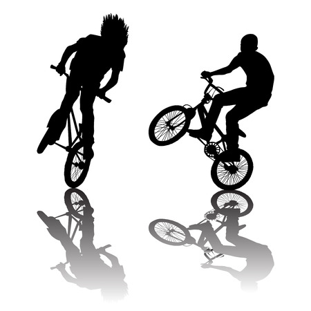 adrenalin: Silhouettes of bikers doing tricks
