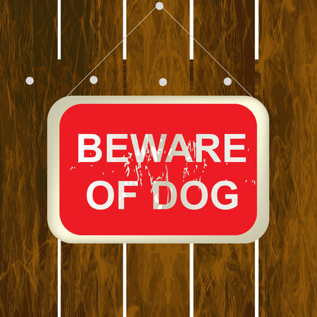 beware of the dog: Beware of a dog sign on a wooden fence