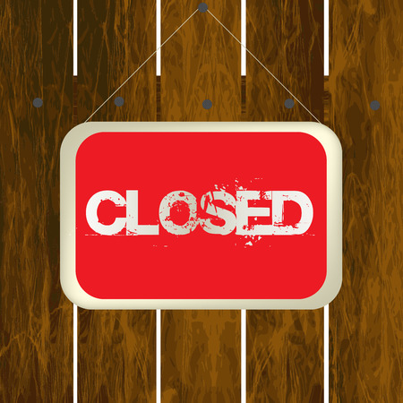 insertion: Closed sign hanging on a wooden fence