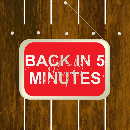 insertion: Back in 5 minutes sign hanging on a wooden fence