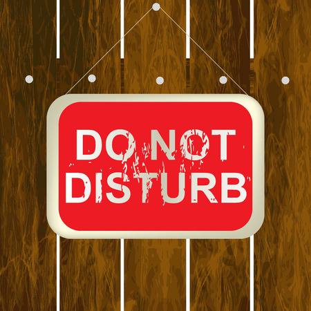 do not disturb sign: DO NOT DISTURB sign hanging on a wooden fence