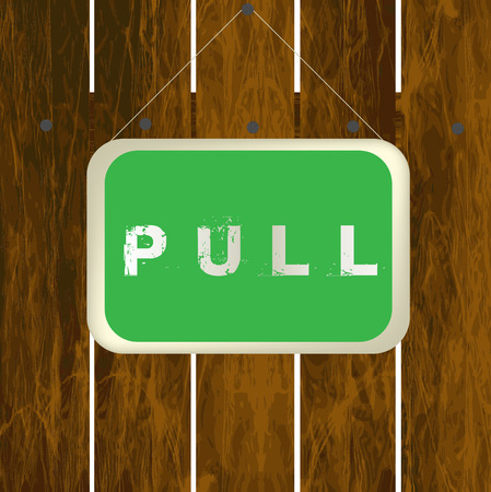 pull: Pull sign hanging on a wooden fence