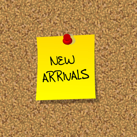 new arrivals: Yellow stick note paper with words NEW ARRIVALS pinned on cork board with red pin