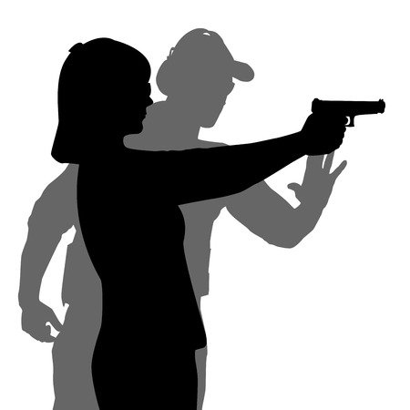 woman with gun: Instructor assisting woman aiming hand gun at firing range