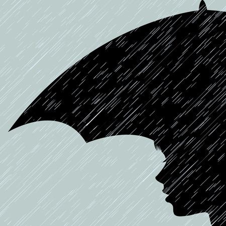 雨の中で傘を持つ少女
