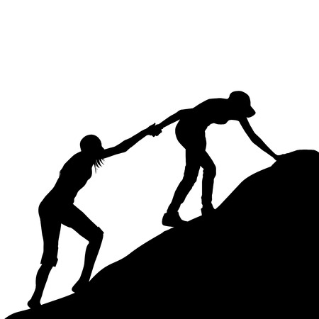 Silhouettes of girl giving helping hand to her friend to climb up the last section of mountain