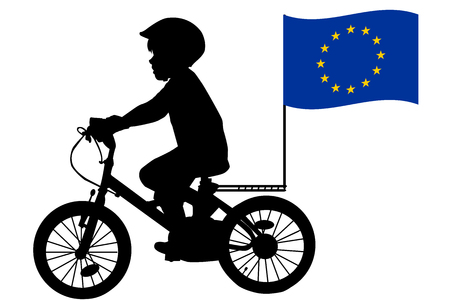 european: A kid silhouette rides a bicycle with European Union flag