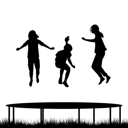 family outside house: Children silhouettes jumping on garden trampoline