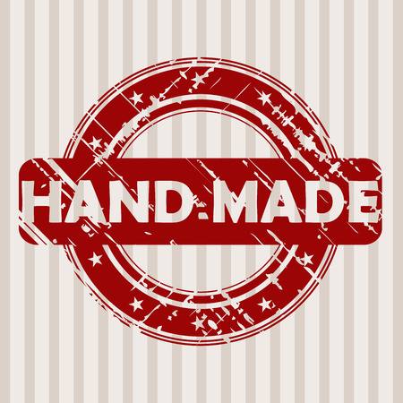 manually: Grunge red rubber stamp with HAND MADE