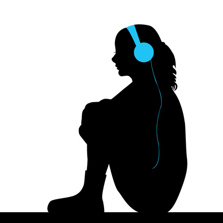 listening to music: Silhouette of sad girl listening music
