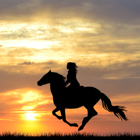 Black silhouette of a woman riding a horse at sunrise Stockfoto
