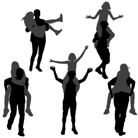 Silhouet van een jonge man die zijn vriendin op de rug of in zijn armen draagt