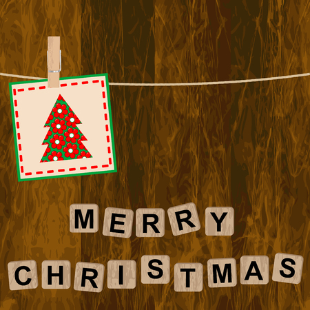 Christmas card with wooden blocks on wooden background