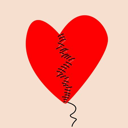 Fixing a broken heart concept with two halves of heart sewed with black thread