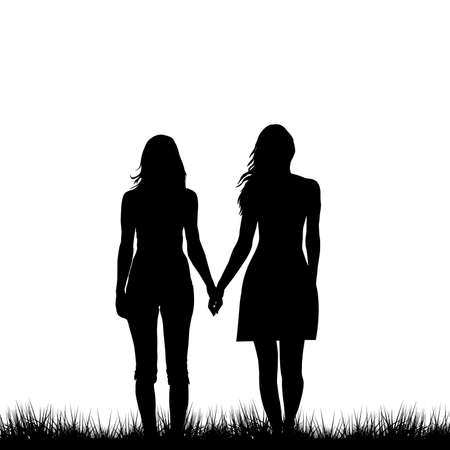 Two young women holding hands walkingon the grass