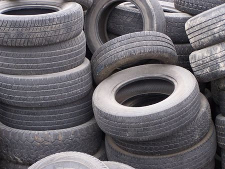 old abandoned and used tires waiting for recycling photo