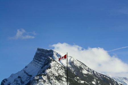Canadian Flag Flying Over The Rocky Mountains photo