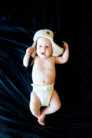 innocent: innocent baby on a black background Stock Photo