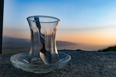 scenary: Empty turksih traditional tea glass on a wonderful scenary