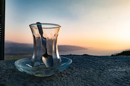 scenary: Empty turksih traditional tea glass on a wonderful scenary