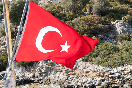 Turkish flag on the rock mountain island background
