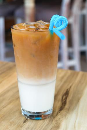 fredo: Iced coffee latte on a wooden table Archivio Fotografico
