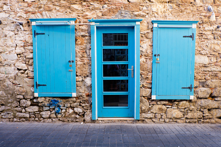 Blue door and windows in a stone house, Marmaris Turkey