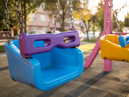 chain swing ride: Colorful swing set at a playground in a park