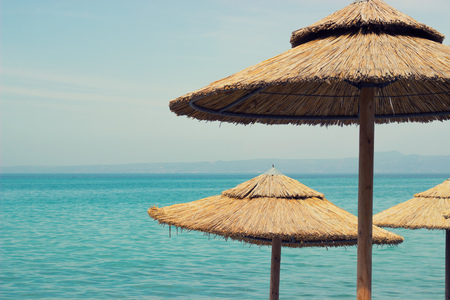 sunshades: Straw sunshades on the beach Stock Photo