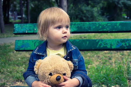 abandon: Toddler sitting on the bench in the park