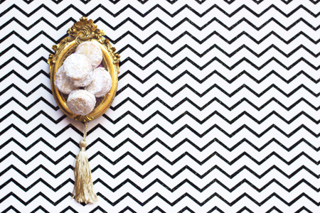 Homemade vanilla and jam cookies, on vintage picture frame or trail, on chevron background with copy space Stock Photo