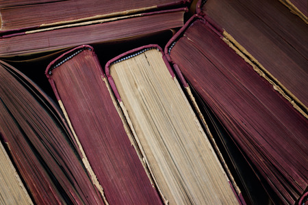 Top view of a stack of old hard back books