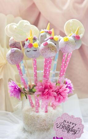 Unicorn cake-pops with flowers and decoration