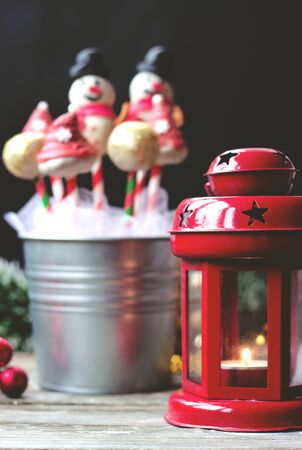 Decorated cake pops on dark background with colorful bokeh background