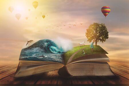 Concetto di un libro magico aperto; pagine aperte con acqua e terra e bambino piccolo. Fantasia, natura o concetto di apprendimento, con spazio di copia Archivio Fotografico