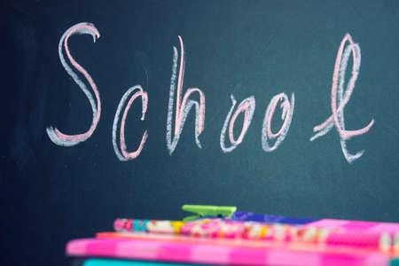 Back to school-chalkboard, notebooks and pencil Standard-Bild - 155924418