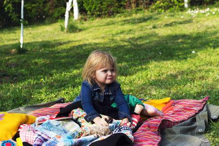 Toddler girl enjoys picnic