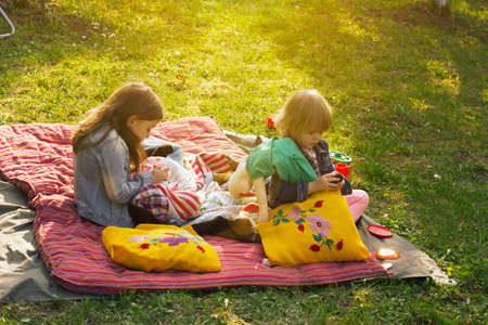 Two little girls having picnic in the backyard