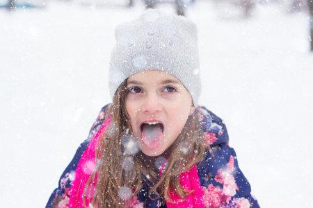 Little girl eating snow