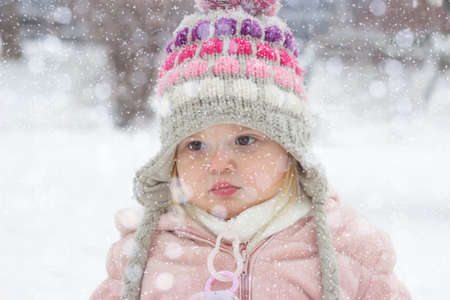 Portrait of a toddler girl on snowy day