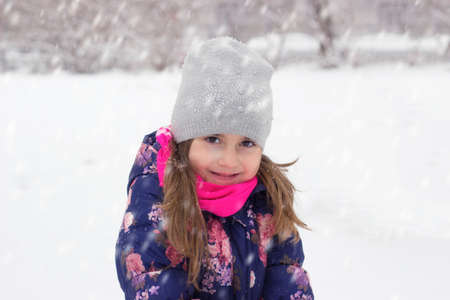 Portrait of a little girl on the snow Stock fotó