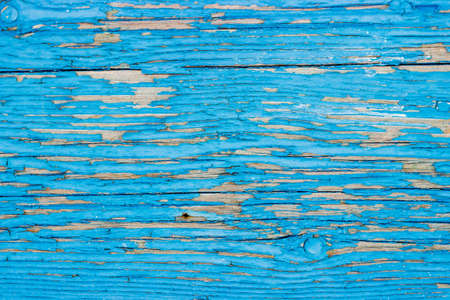 Close up of a old wooden door, teal blue paint peeling off; texture background 版權商用圖片