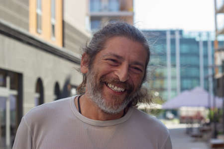 Middle aged man, looking at camera and smiling