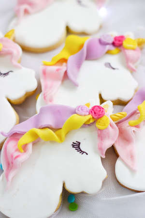 Unicorn royal icing cookies; food background