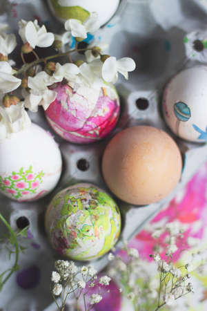 White eggs in the cardboard box, prepared for decorating; Easter background